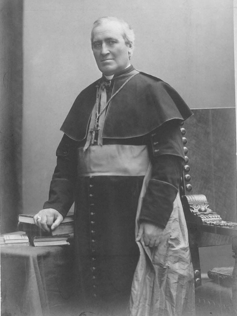 Archbishop John Ireland posing for a photo.