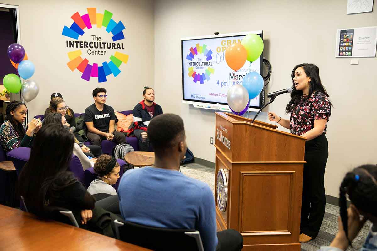 Hunter Santos speaks to a group at the grand opening celebration of the Intercultural Center.