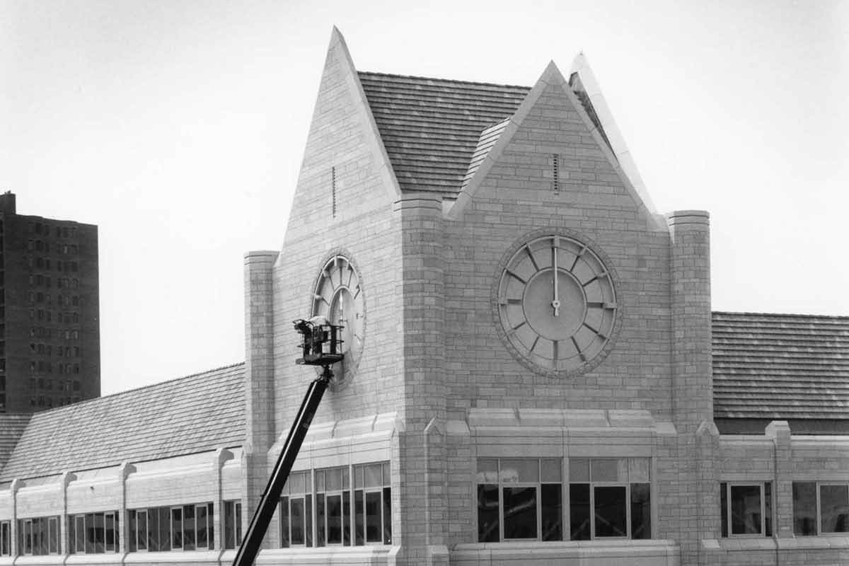 Work being performed on the clock tower of Terrence Murphy Hall.