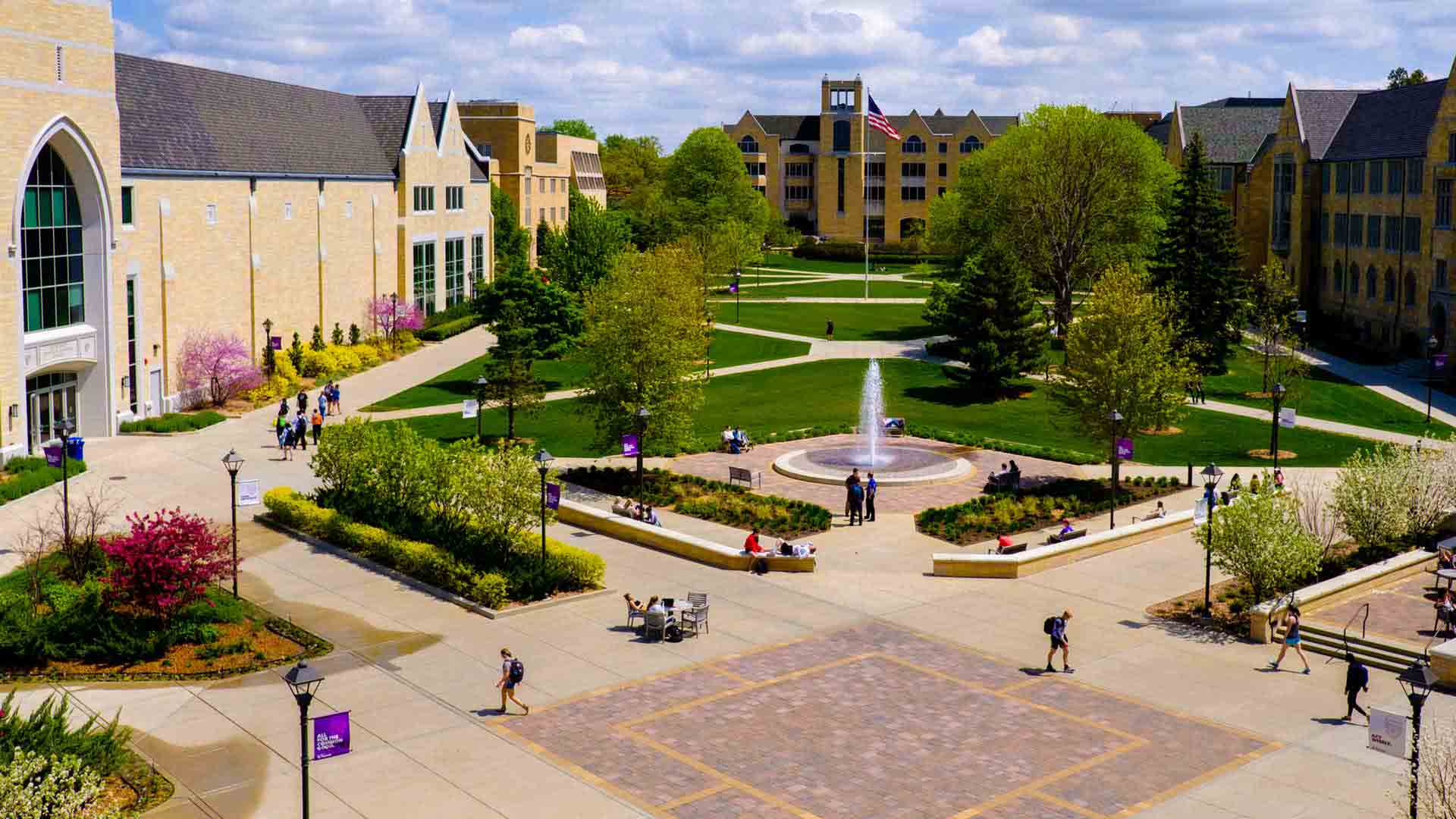 Aerial view of the John P. Monahan Plaza, Harpole fountain, lower quad and O'Shaughnessy-Frey Library.