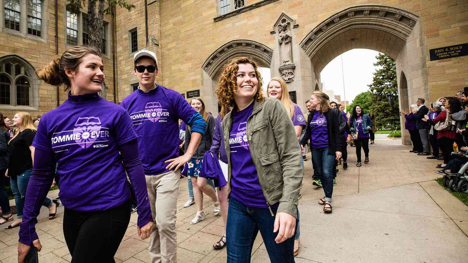 Students walk through the Arches during the senior class March Out of the Arches.