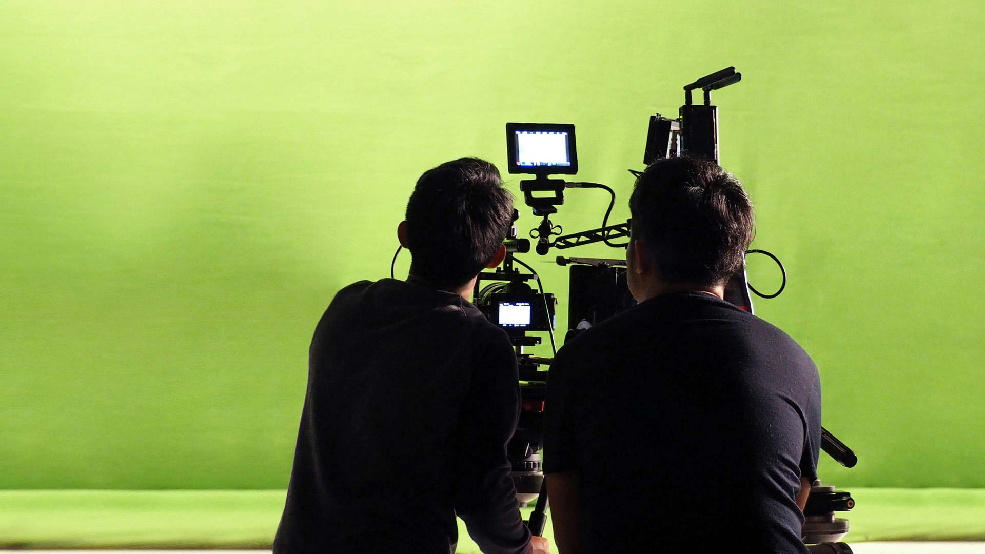 Filming on a greenscreen stage.