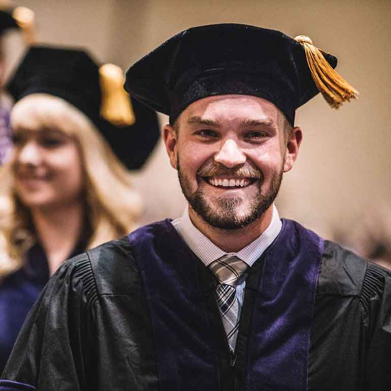 Student walk in during the 2018 School of Law Commencement Ceremony