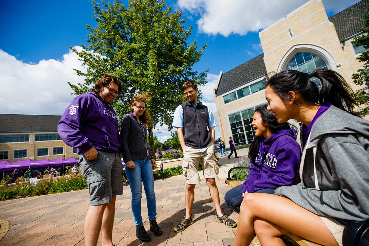 Students chat on the John P. Monahan Plaza.