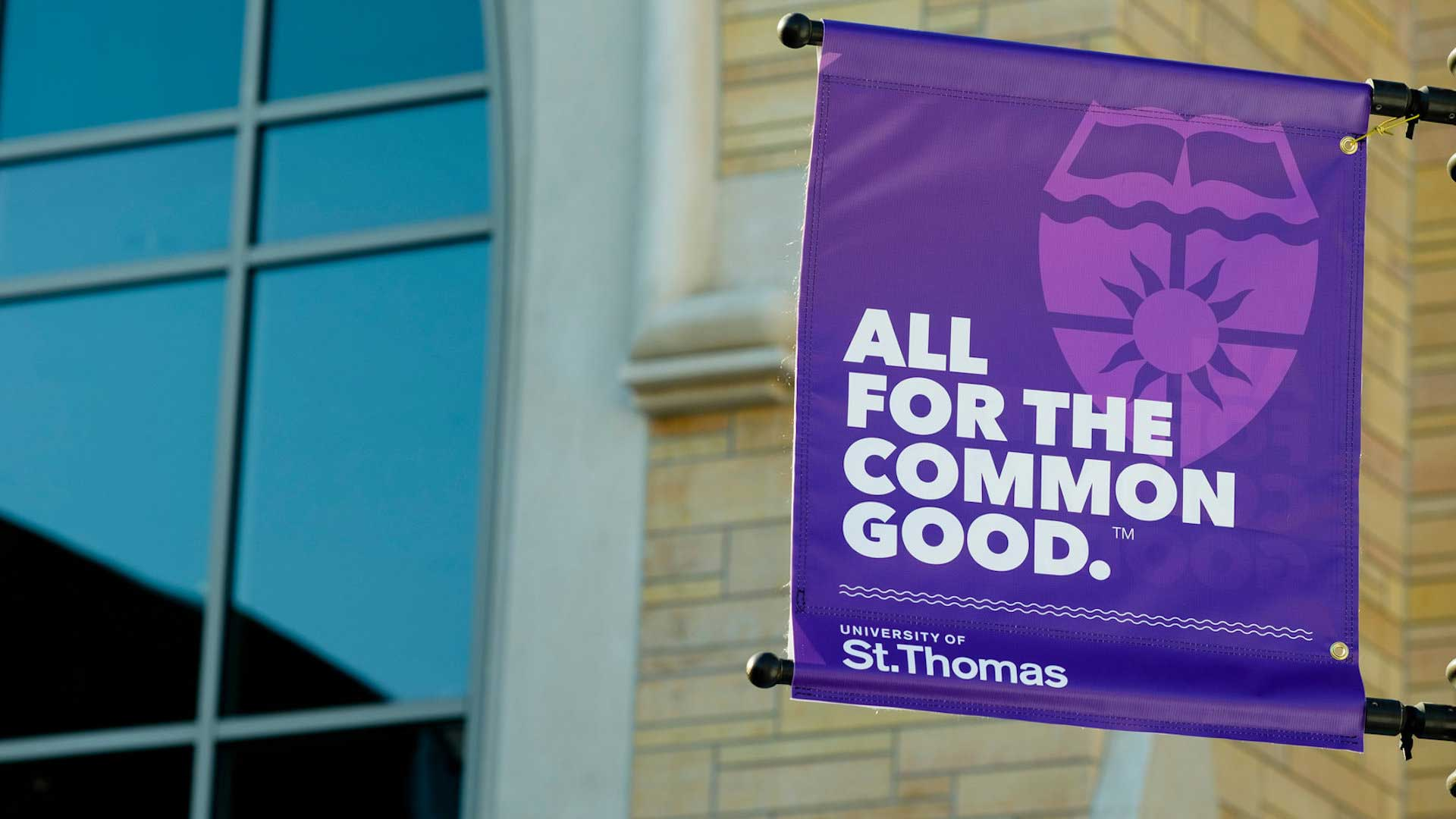 "University of St. Thomas ""All for the Common Good"" banner"