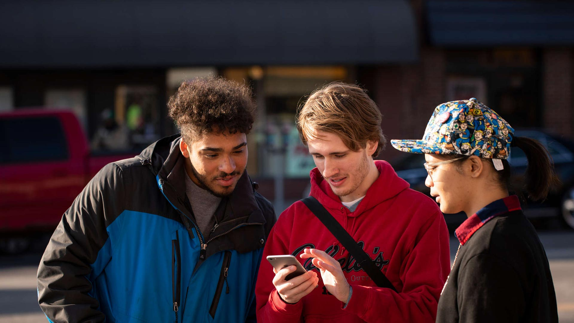 Students look at a smart phone