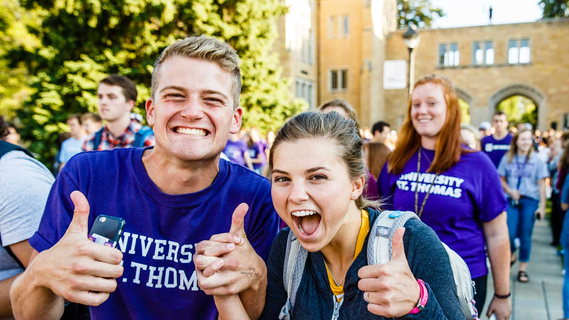 Students smile for the camera during the March Through the Arches in September.