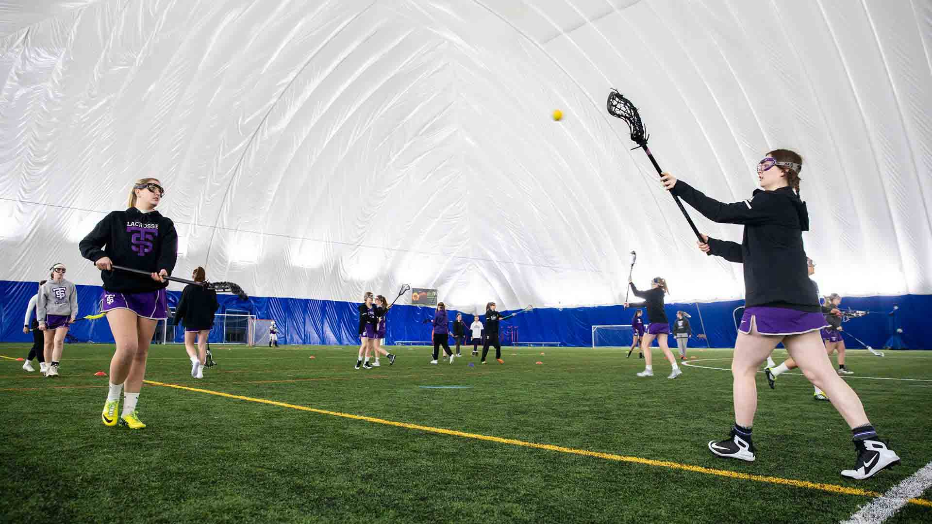 Women's club lacrosse team during their game against St. Olaf.