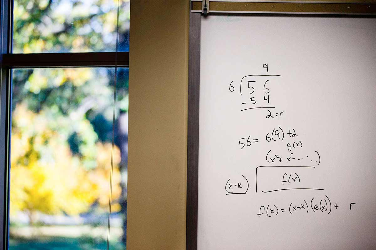 A math formula on a white board in the math resource center.