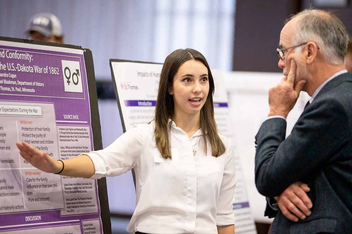 A students presents her findings during the Undergraduate Research Poster Session.