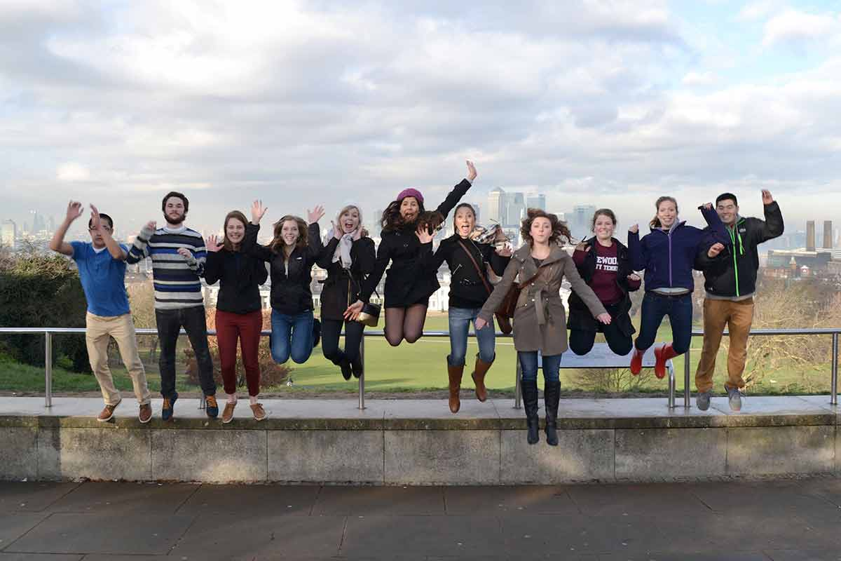 Students in London jumping in photo.