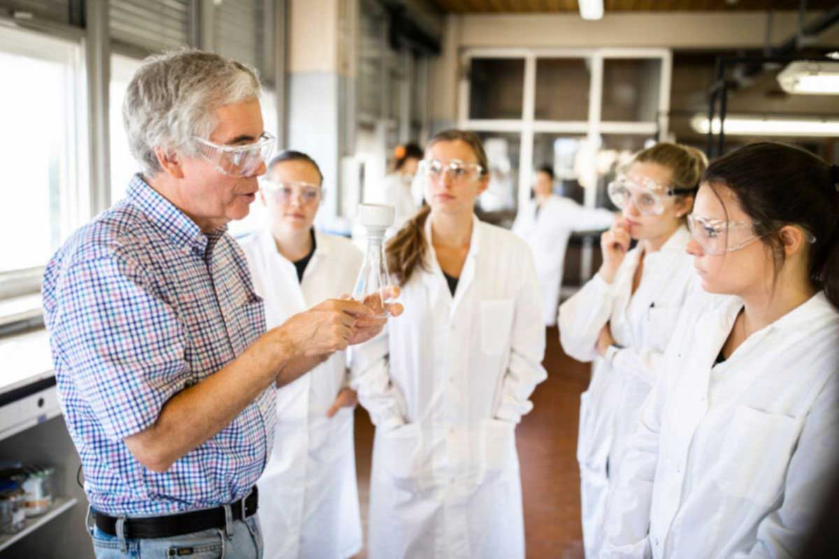 Chemistry professor Bill Ojala instructs students in a lab in Rome, Italy.