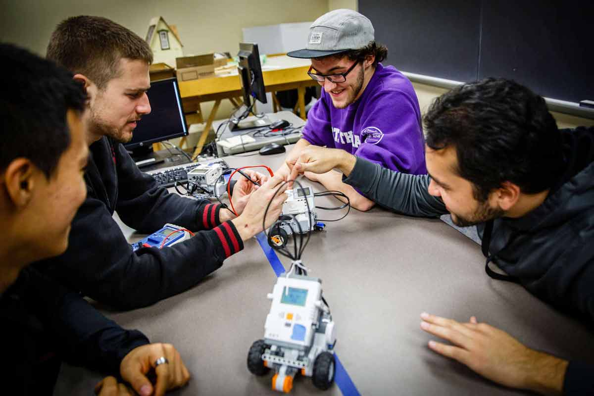 Students work with a lego robot