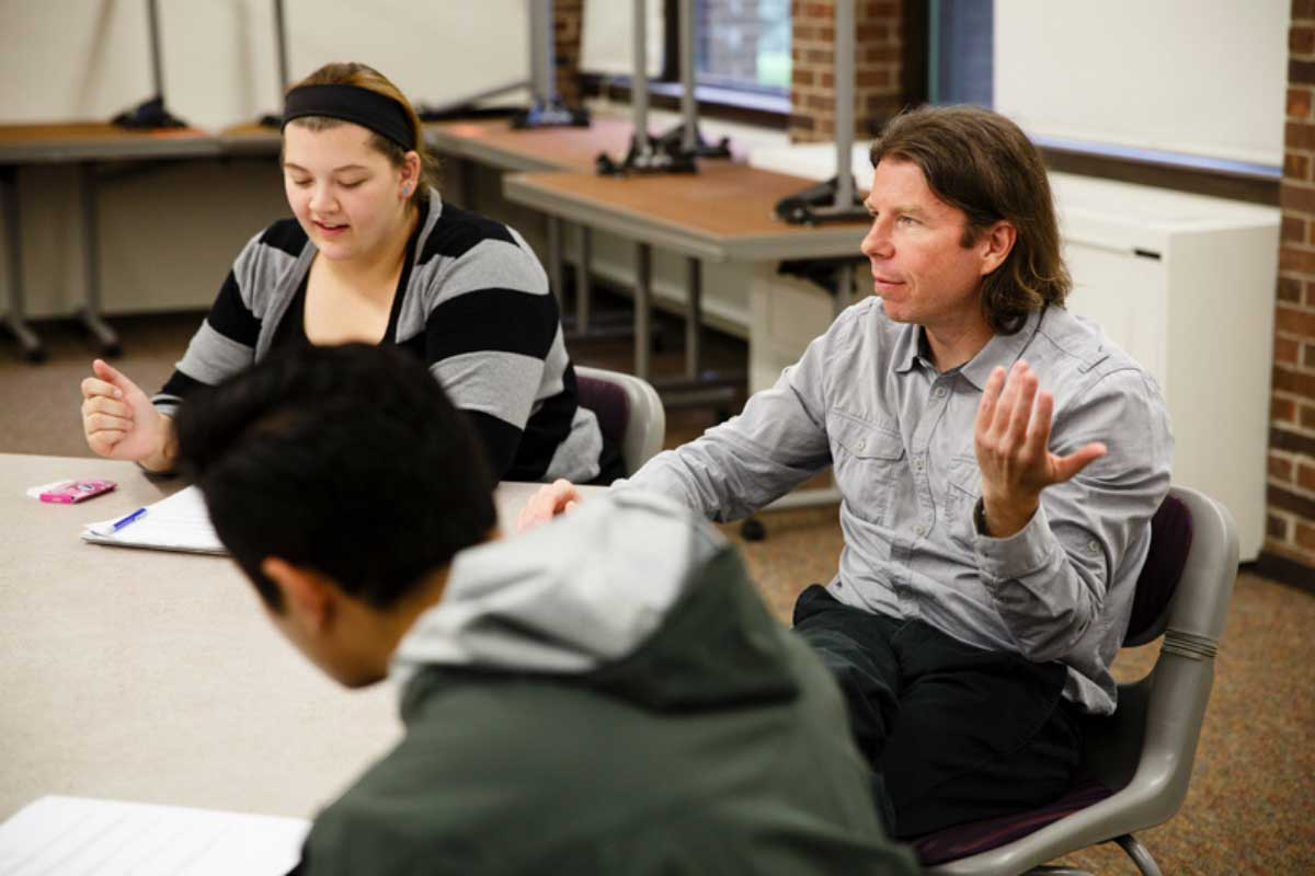 Film Studies adjunct faculty member James Snapko leads a discussion with students.