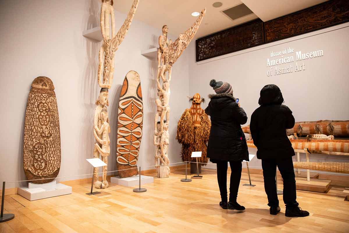 Students visiting the American Museum of Asmat Art