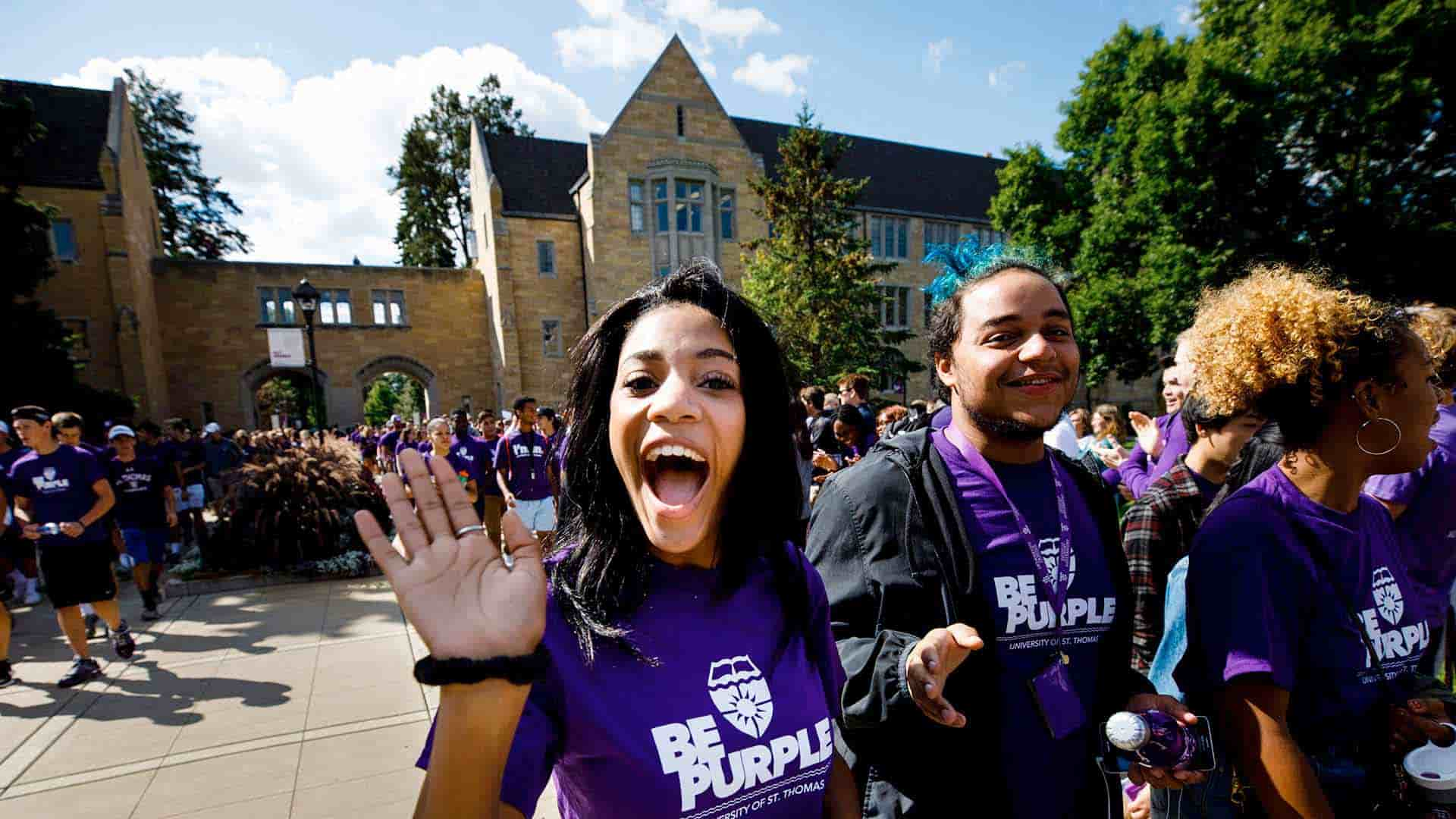 Freshman students march through the arches on the St. Paul, University of St. Thomas campus.