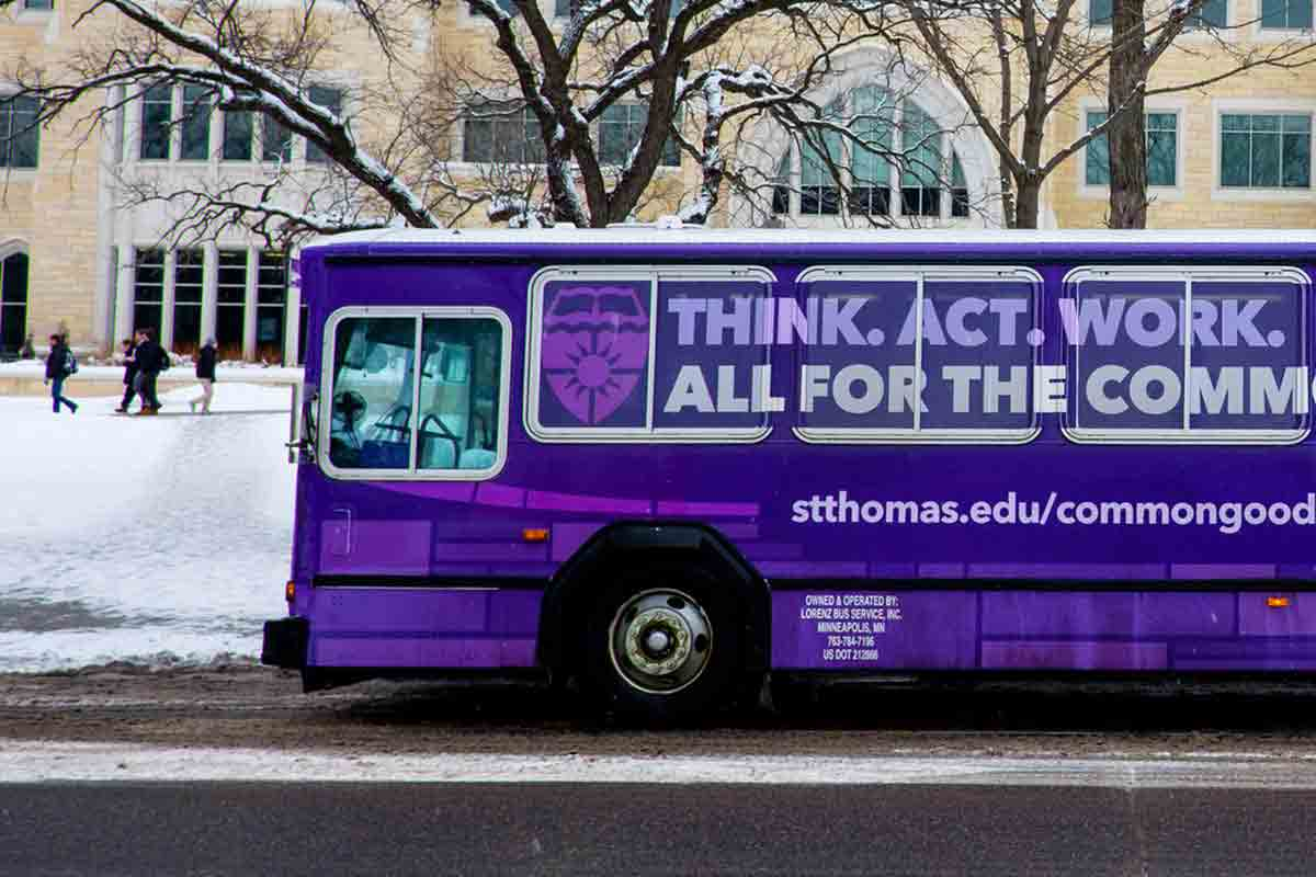The St. Thomas shuttle bus drives near Summit Avenue.