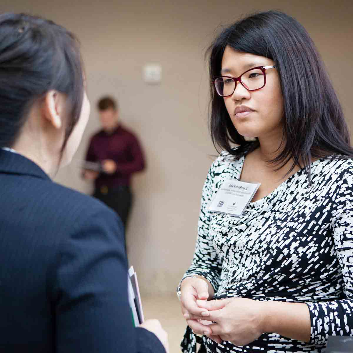 Employers interact with students and alumni at a University of St. Thomas career fair.