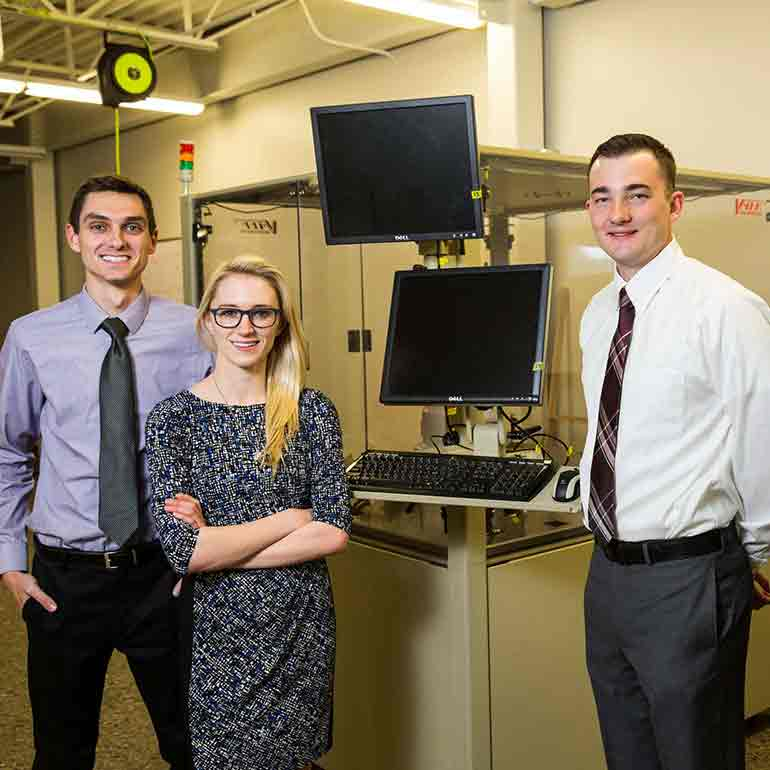 Spring Engineering Senior Design Team members, from left, Logan Falzone, Lindsey Bollig, Samuel Fillmore and Mark Whitehead (all mechanical engineering majors), taken on February 8, 2017 in the Facilities and Design Building in St. Paul.