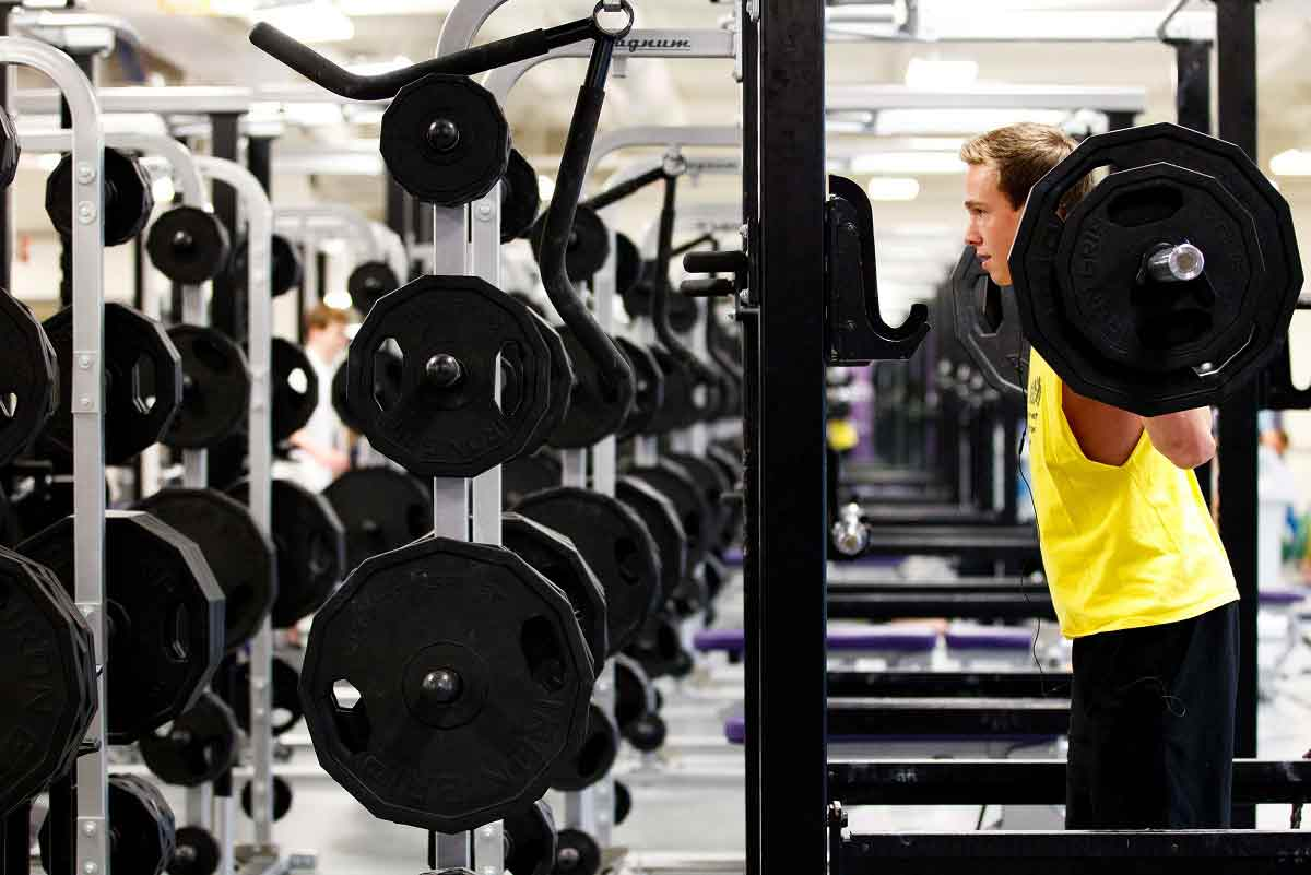 A student lifts weights in the weight room of the Anderson Athletic and Recreation Complex February 28, 2012.