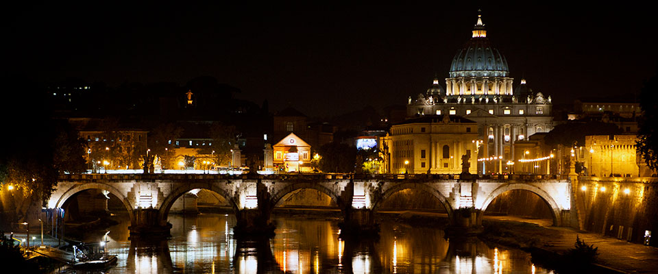 St. Peter's Basilica is seen at night with the Tiber River and the Ponte Sant'Angelo bridge in the foreground October 16, 2010 in Rome, Italy at night.