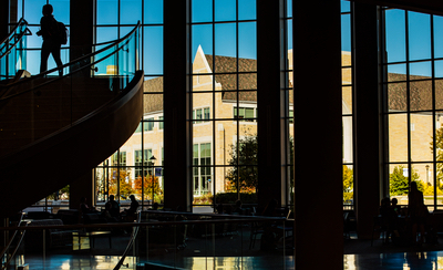 A student walks up the steps in the Anderson Student Center atrium