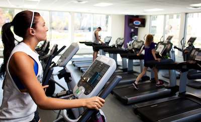 A student uses a workout machine in the Anderson Athletic and Recreation Complex
