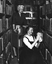 Shelving books in the old Library
