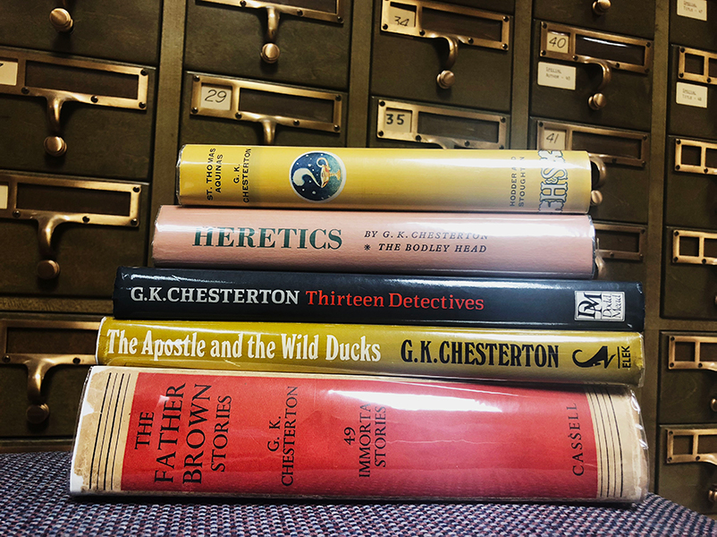Five books from the Chesteron-Belloc Collection stacked