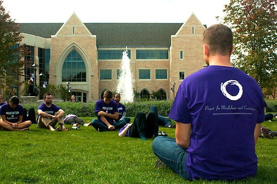Group meditating on the lawn
