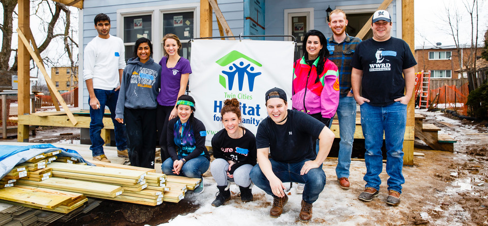 St. Thomas law school students volunteer for a public service event with Habitat for Humanity