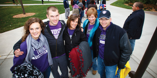 A family shows support by wearing Tommie apparel